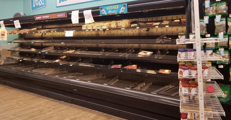 Empty meat cases at a grocery store