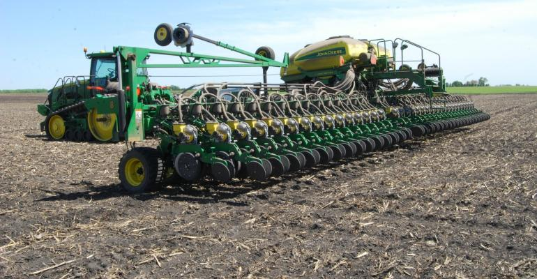 planter in a field / BIG GAIN: Of the top corn-producing states, Iowa is furthest along in planting, with 78% of its crop in the ground.