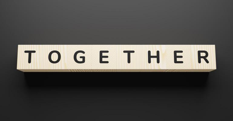 Together spelled with wooden cubes