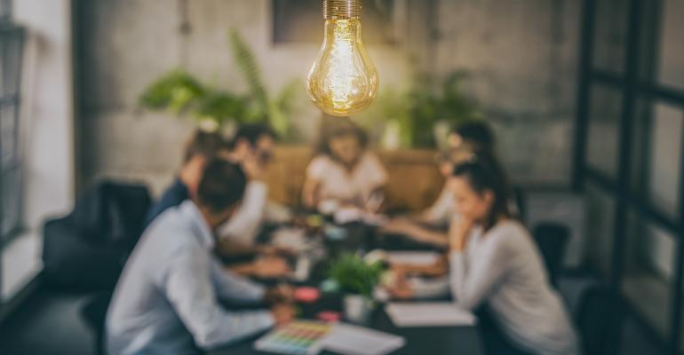 lightbulb hanging above meeting table