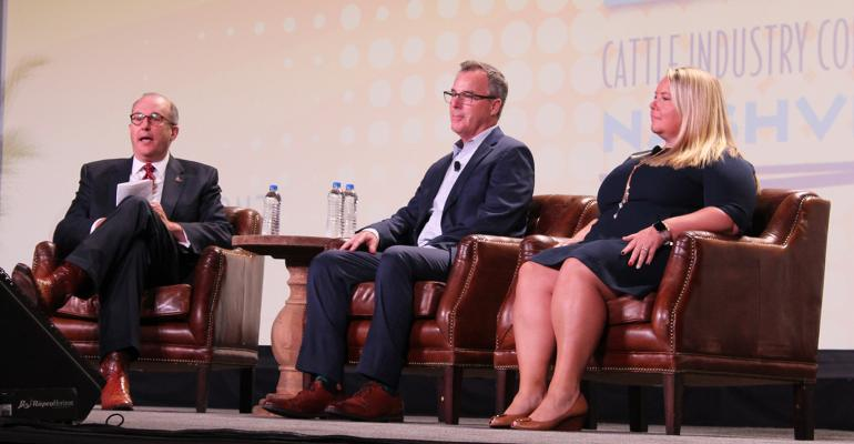 NCBA CEO Collin Woodall, left, leads a panel discussion with David Norton of Sysco, the leading food service distributor, and Kristine Young with Darden Restaurants