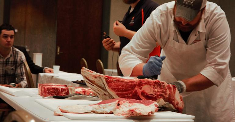 Ben Peterson carving cuts of beef
