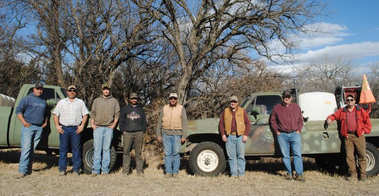 A few members of the Bristow, Neb. area crew pose in front of the trucks they purchased to help on prescribed burns