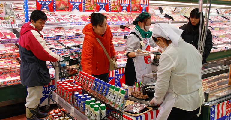 Customers sample U.S. beef at Tokyo supermarket