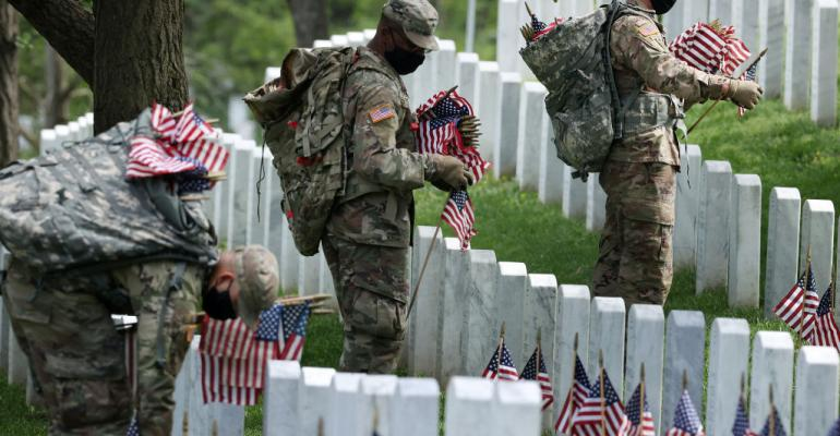 Soldiers place flags at Arlington National Cemetery