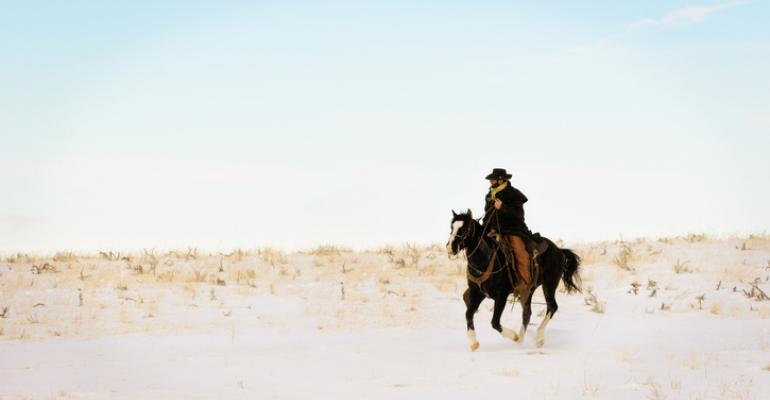 Cowboy on horseback in winter