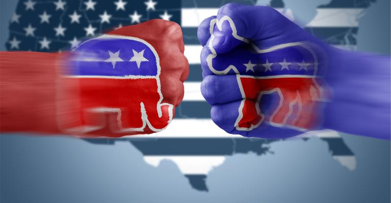 Republican and Democrat fists bump in front of map of United States