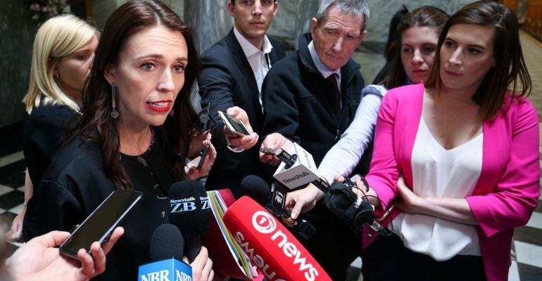 Prime Minister Jacinda Ardern speaks to media on her way to the house at Parliament on Nov. 8, 2017, in Wellington, New Zealand.