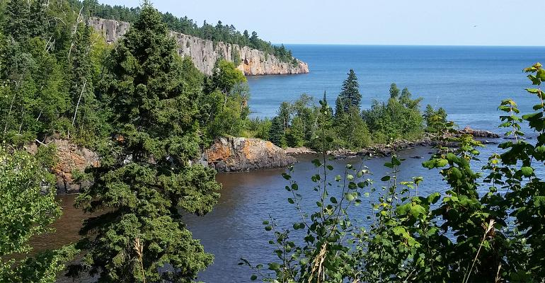 rocky, forested coastline of lake