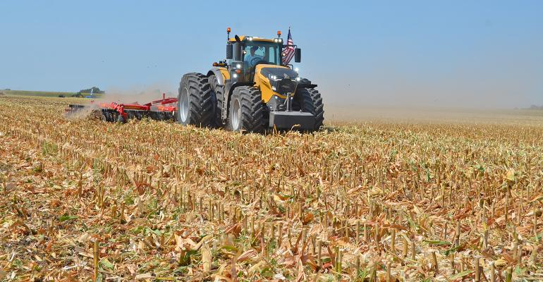 tractor pulling disk in corn stubble