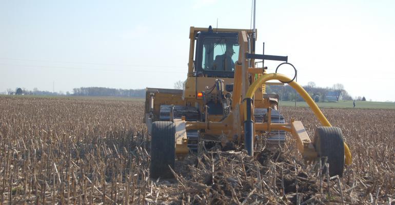tile plow in field