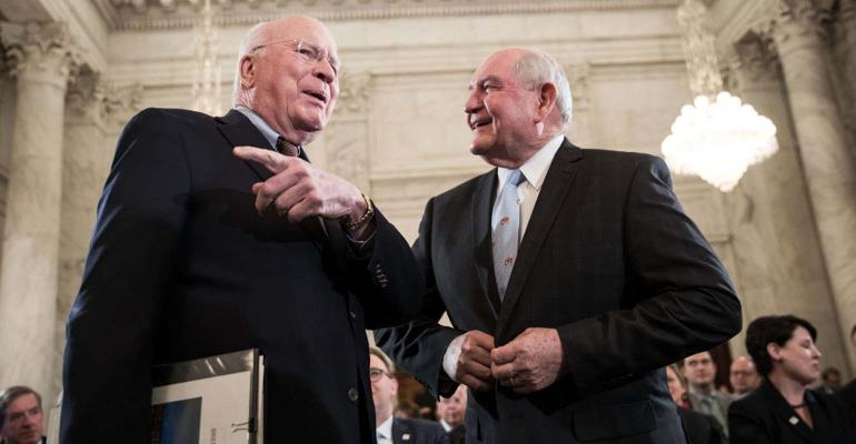 Sonny Perdue talks to Patrick Leahy before his Senate confirmation hearing.