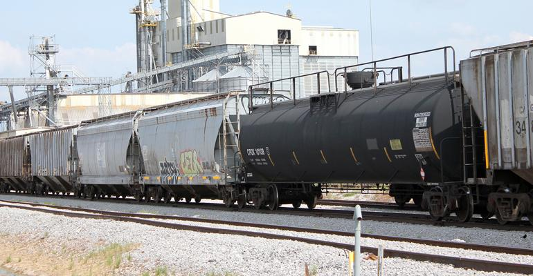 Train cars at grain facility