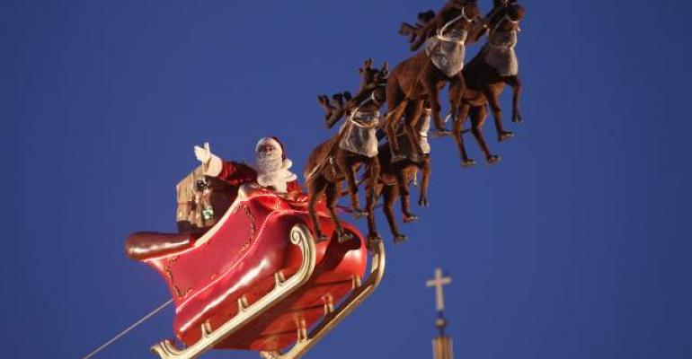 Santa and his Reindeer fly through the night