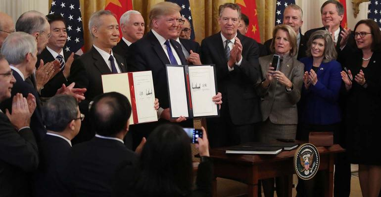 President Donald Trump and Chinese Vice Premier Liu He, hold up signed agreements of phase 1 of a trade deal between the U.S. and China, in the East Room at the White House, on January 15, 2020 in Washington, DC.
