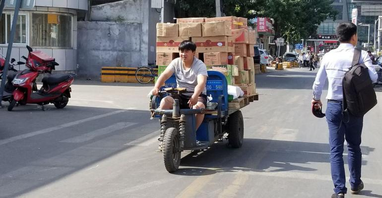 Transporting meat products out of frozen meat market in Beijing, China