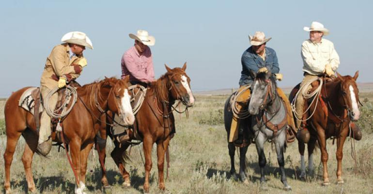 Working cattle on horseback