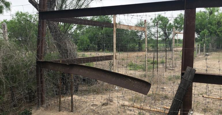 damaged fence at border Kris Ede Brian King .jpeg