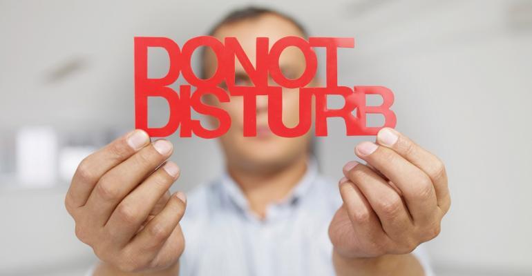 Man showing do not disturb sign