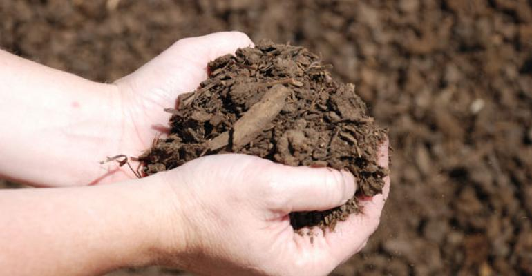 M/M Feedlot Composts To Solve Expansion Dilemma