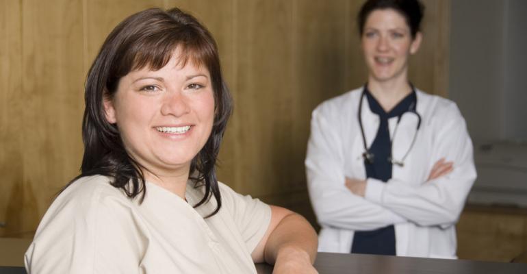 Smiling vet and customer