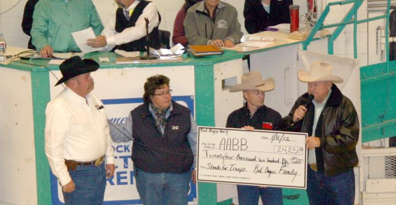 Left to right Red Angus breeders Barry Horsley and Cheramie Viator presented a check to National Guard Sgt Dave Callahan who represented all the soldiers who benefit from the All American Beef Battalion steak feeds Jim Odle right purchased possession of the bull 21 Gun Salute