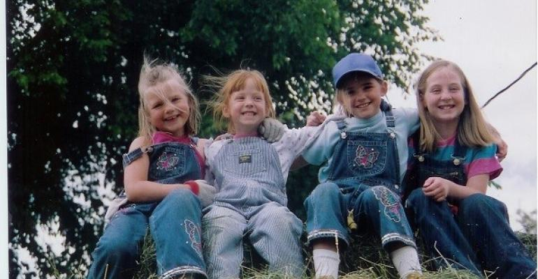 My cousin Mikayla sister Laura cousin Kristin and I after baling hay