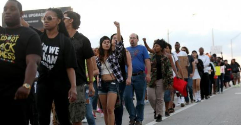 Street protesters: Be mad at the government, not police