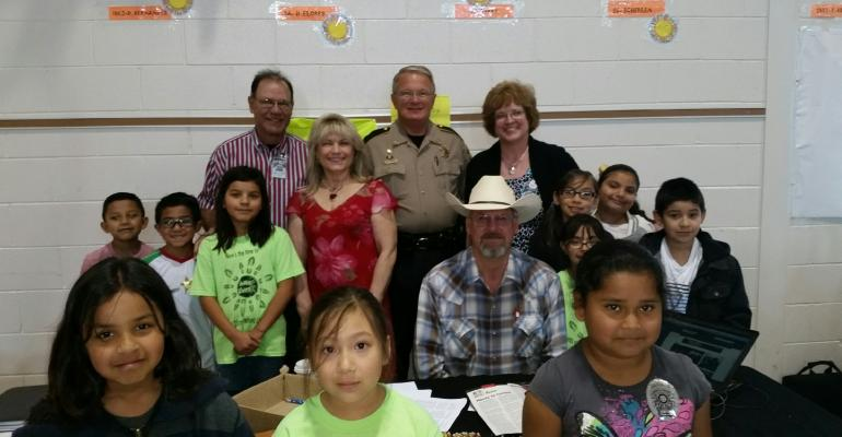 BEEF Senior Editor Burt Rutherford with some of the kids and adults involved with a career fair