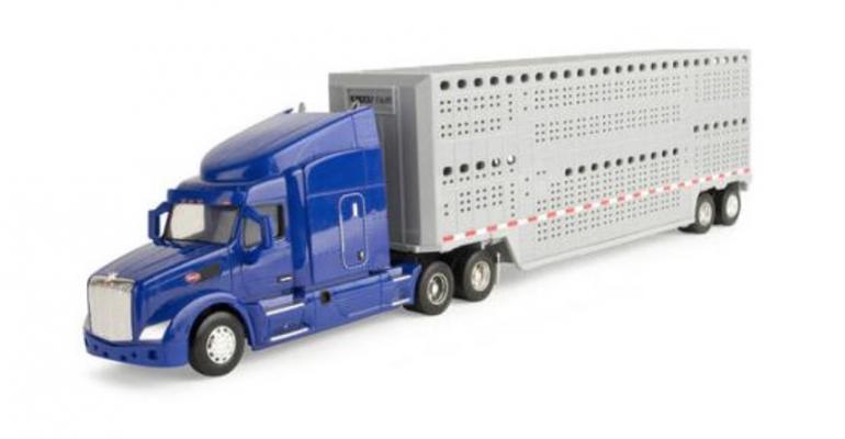 """Vegan activists flip over Walmart toy """"slaughterhouse"""" truck"""