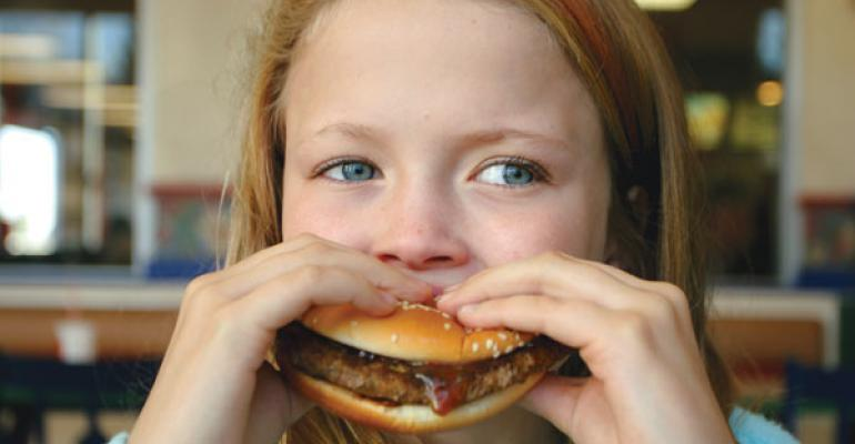 Young child eating beef
