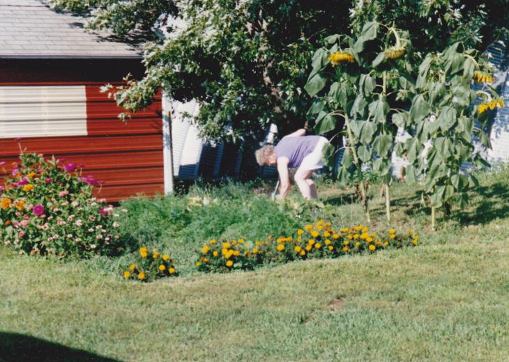 Mom tends her garden on the prairie