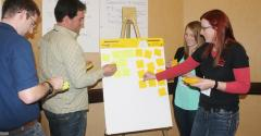 Workshop participants brainstorming with sticky notes