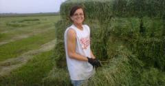 Amanda throwing square bales