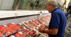 Consumer at beef case