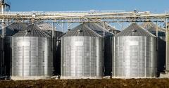 grain bins on a background of blue sky