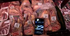 Cell phone at meat case