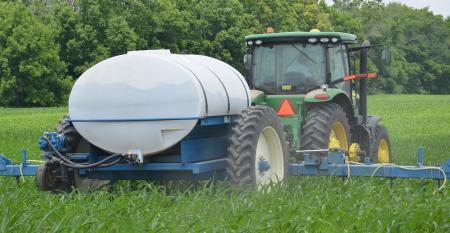 tractor applying nitrogen in cornfield