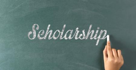 Scholarship chalk on blackboard