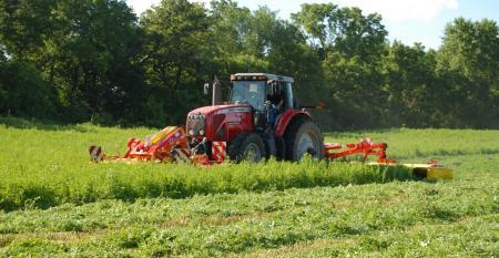 Tractor mowing alfalfa hay