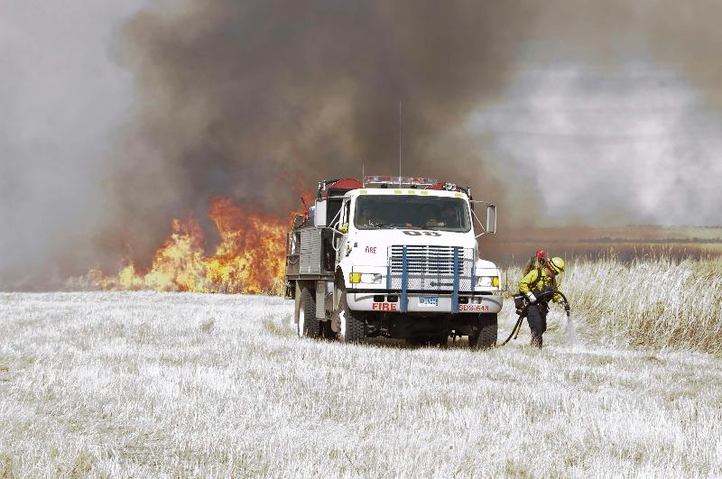 Firefighters work closely when doing prescribed burns