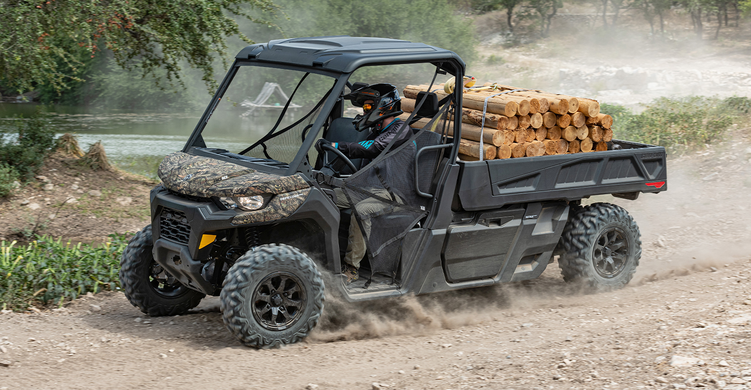 Can-Am  Defender Pro hauling logs in its six-foot bed