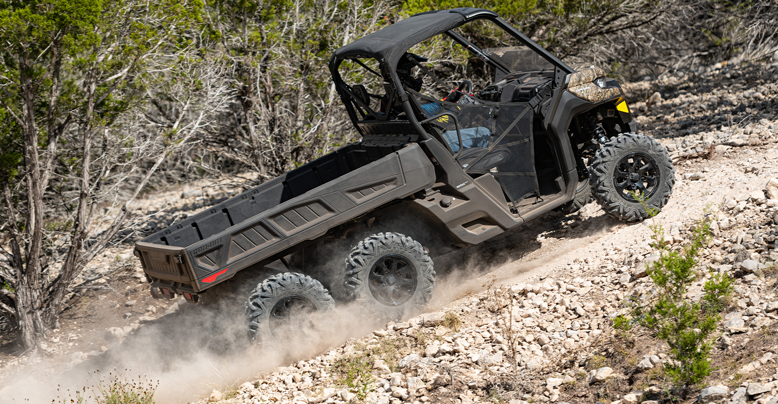 The 6x6 model Can-Am Defender climbs a steep hill